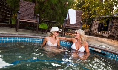 Enjoy quiet conversation at the whirlpool spa nearby the pool.