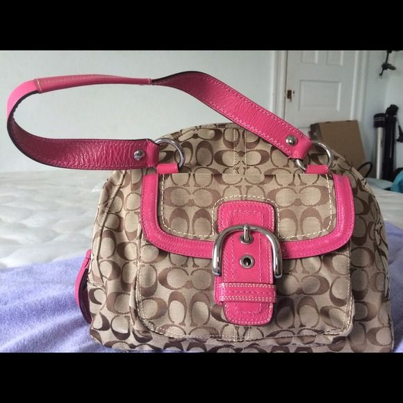 Authentic pink coach purse 100% authentic pink and tan Coach handbag. Like new Coach Bags