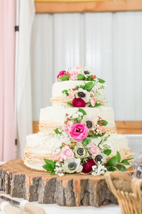 3 Tier White Rustic Wedding Cake With Wood Round Base Covered In Pink And White Flowers Wedding Cake Stands Wedding Cake Alternatives Dessert Bar Wedding