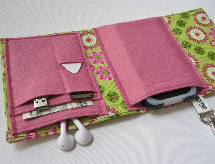 Nerd Herder gadget wallet in Boho Blossum for iPod, Android, iPhone, camera, earbuds, SD cards, USB, batteries, guitar picks, IDs, cards. $32.00, via Etsy.