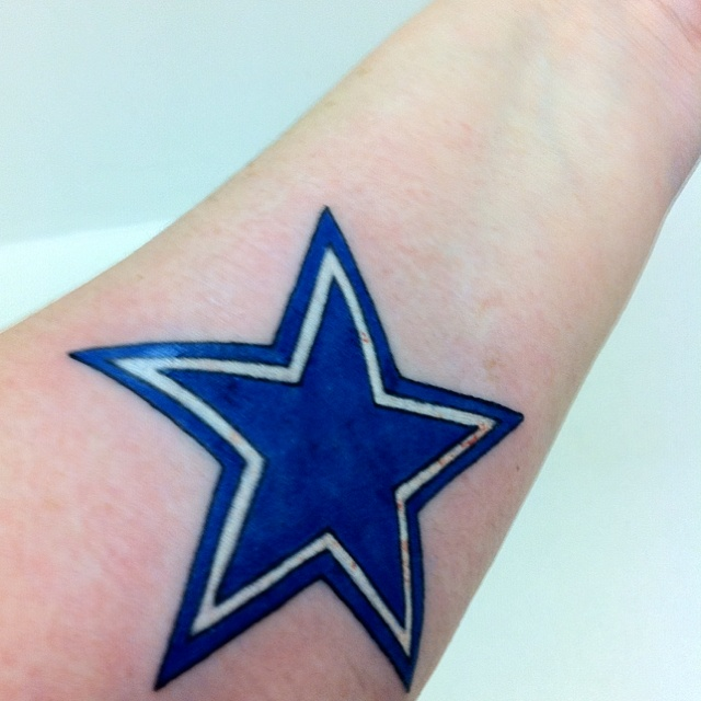 Freshly inked Dallas cowboys tattoo