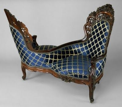 Victorian by Belter furniture - Rococo revival. Would rather this in a black and purple motif.