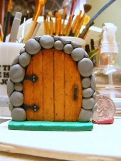"""fairy door - made from polymer clay - I like the details of the hinges, boards, handle, but what I really love are the """"rocks"""" the door is set in - nice job! +++++++++++++++++ for Franni by coltpixy, via Flickr #fairy #garden #door"""