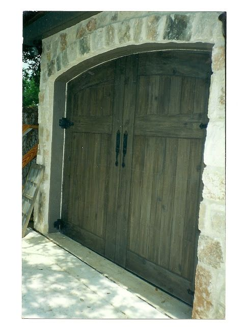 These are regular white metal garage doors painted to look like barn doors!  No tutorial, but I would LOVE this on my house!!!
