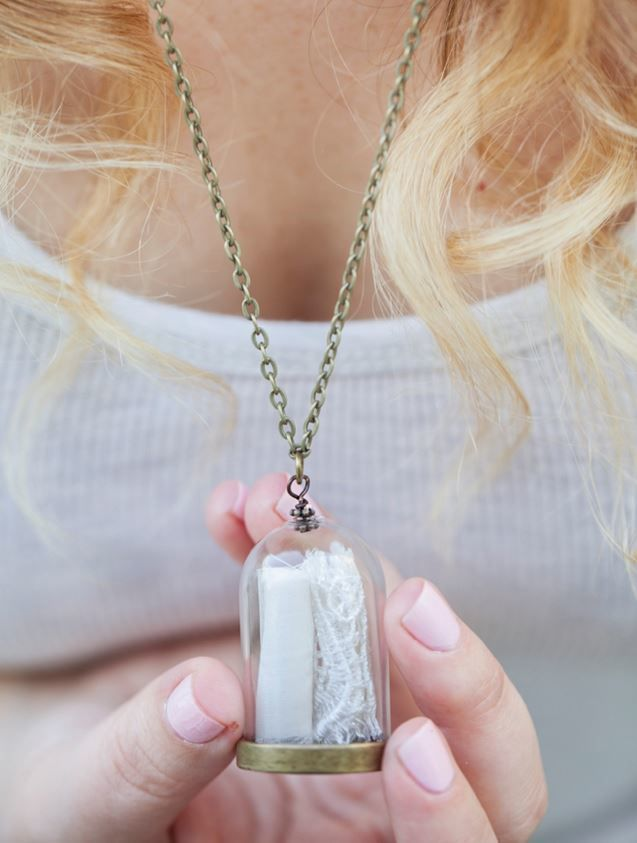 If you don't know what to do with your wedding dress after your wedding, you probably haven't seen this Wedding Dress Keepsake Necklace.