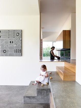 The stairs are the key spatial device that connects and divides each component of the house. Artwork: Natalie Puantulura. Preston Lane Architects renovate a Tasmanian house | Architecture AU