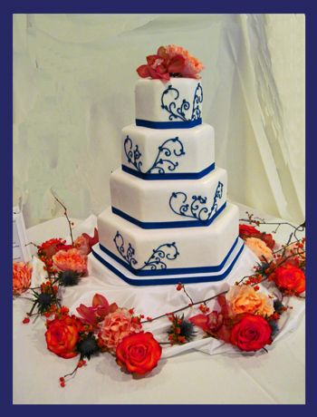 Royal Blue Scrolls, Hexagon Wedding Cake decorated with Fall flowers and bittersweet.  Tastefully Wright, LLC, New Hampshire