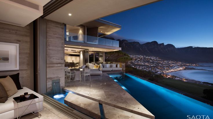 ZA Clifton 2A:Overlooking Clifton and Camps Bay beaches, this house is formed around a sculpted courtyard which contains all external living...