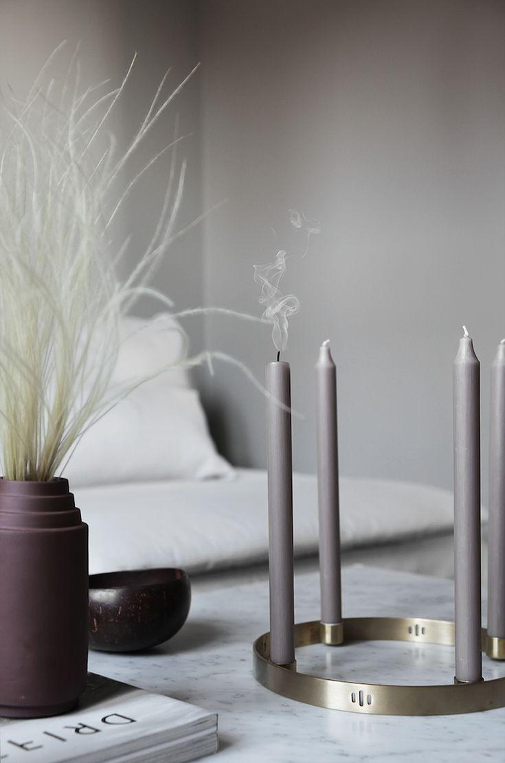 Grey candles, brass candleholder in the Norwegian Home of Elisabeth Heier.