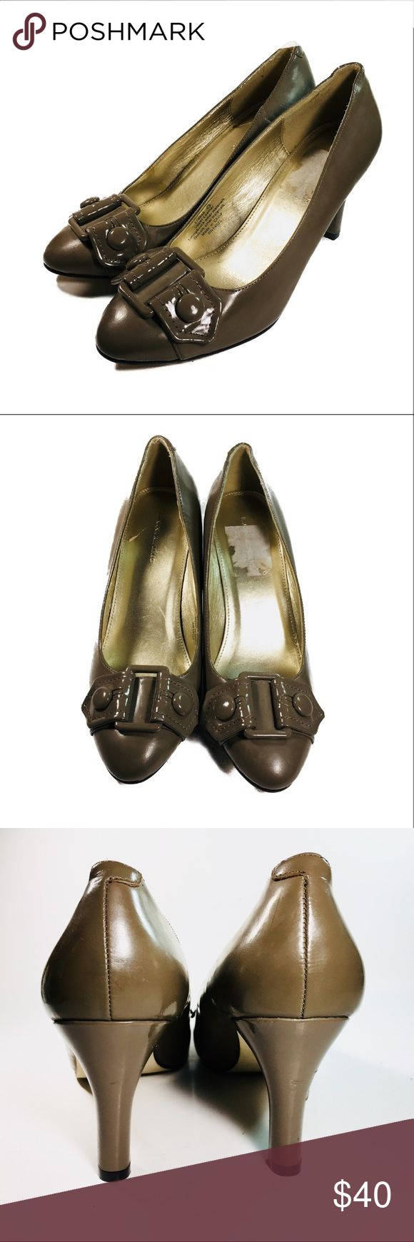 """Banana Republic Taupe Leather High Heel Pumps 7.5 Medium taupe tone Size 7.5 Women's Shoe ~3.5"""" across ball of foot 3"""" heel Button Buckle Toe Accent Heel scuffs / dents as pictured Small tear left insole, sticker right insole Leather upper shows minor wear, soles and heels in good condition. Lighting makes photos look very brown, but they are definitely taupe. Image from back of shoes is closest to actual color. It's almost a gray taupe. Buyer understands color may vary depending on lighting…"""