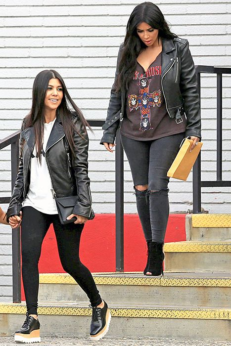 Kourtney and Kim Kardashian are seen filming their reality show 'Keeping Up With The Kardashian's' at a bowling alley in Calabasas, California on July 1, 2015.