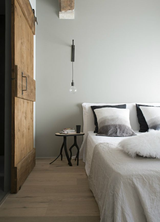 Marie Laure Helmkampf. Industrial Bedroom With Barn Door,, White And  Charcoal Bedding