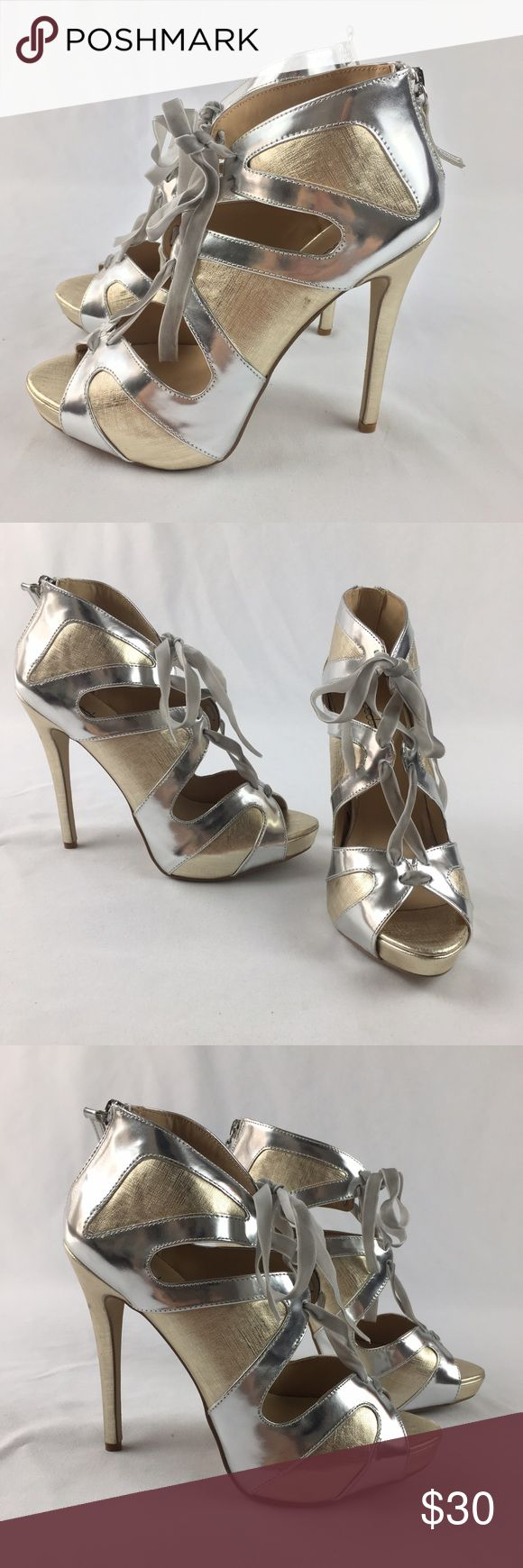 New Shoe Dazzle Kecia Gold & Silver Lace Up Heels New Shoe Dazzle Kecia Gold & Silver Lace Up Heels. Peep toe. Laces up the front. Beautiful shoes. A few minor scuffs as pictured (reflected in pricing) New, never worn. Size 9. With 5 inch heels Shoe Dazzle Shoes Heels