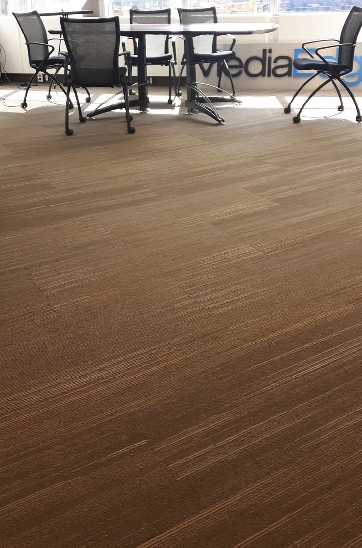 """This Shaw Contract carpet was recently installed at MediaEdge, a Toronto-based business-to-business communications provider. MedaEdge recently renovated, adding a new wing to the North York office of this growing company. MediaEdge used a carpet tile from the Shaw Contract called Blur Tile. The 18"""" x 36"""" multi-level pattern loop carpet tile was installed in a brick formation exhibiting a contemporary feel throughout."""