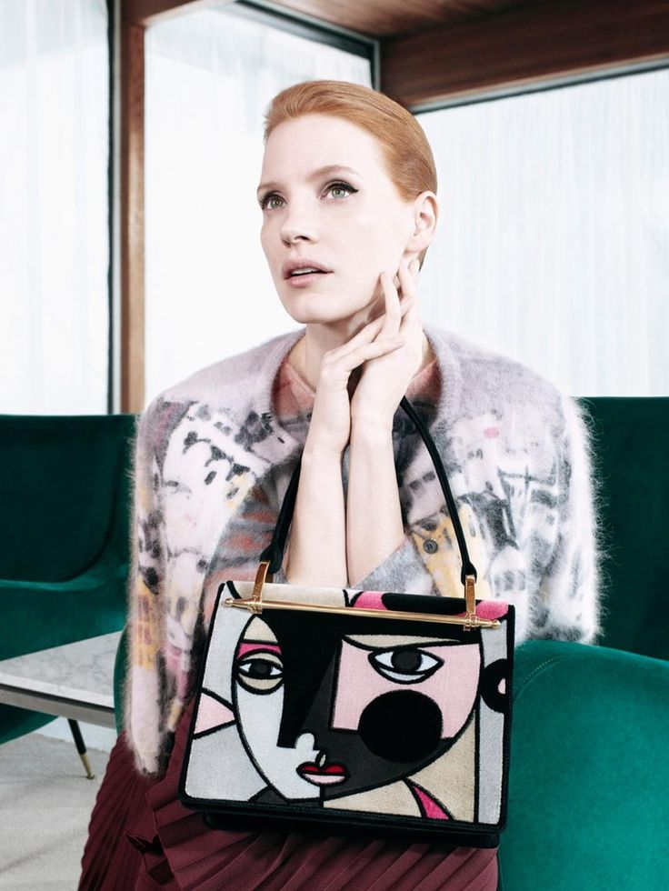 Jessica Chastain poses with graphic print bag in Prada's pre-fall 2017 campaign