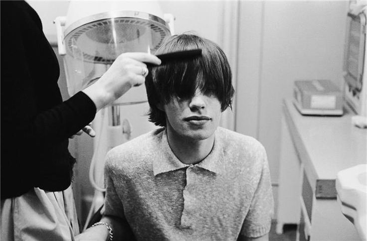 Mick Jagger having his hair styled at the BBC studios before an appearance on television, 1963.   (© Terry O'Neill)