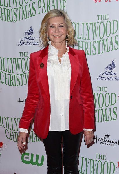 Olivia Newton-John Photos Photos - Olivia Newton John attends the 85th annual Hollywood Christmas parade on Hollywood Boulevard in Hollywood, on November 27, 2016. / AFP / CHRIS DELMAS - 85th Annual Hollywood Christmas Parade - Arrivals