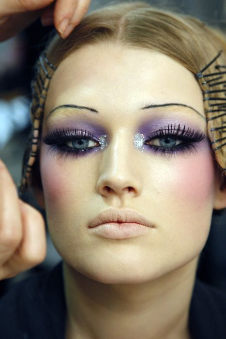 The Beauty Model. Love her purple smokey eyes. Notice. Her real brows are concealed with makeup.