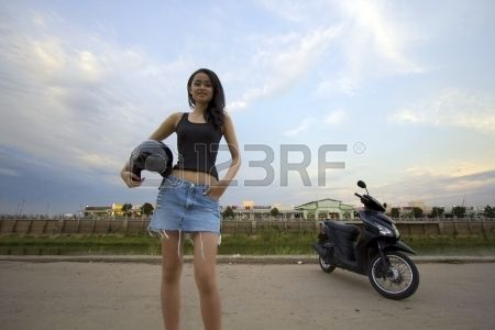 sexy asian girl with mini skirt helmet motorcycle in cambodia Stock Photo