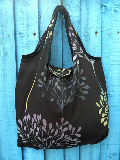 Fold-away shopping bag tutorial. This is a great bag and even easier to make if you don't use bias tape. I just serge the edges and then fold over and sew. PDF instruction downloadable.