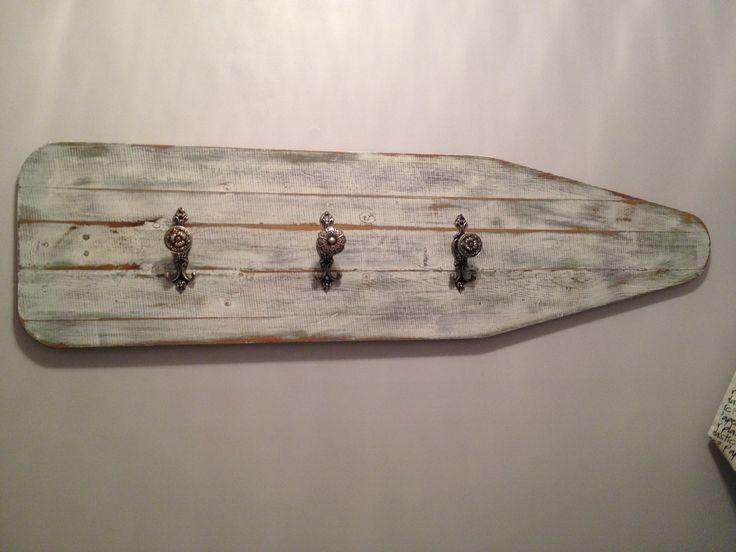 Vintage ironing board wall hooks. Took the metal legs off, painted, sanded and attached the hooks. Great for hanging aprons and canvas grocery bags.