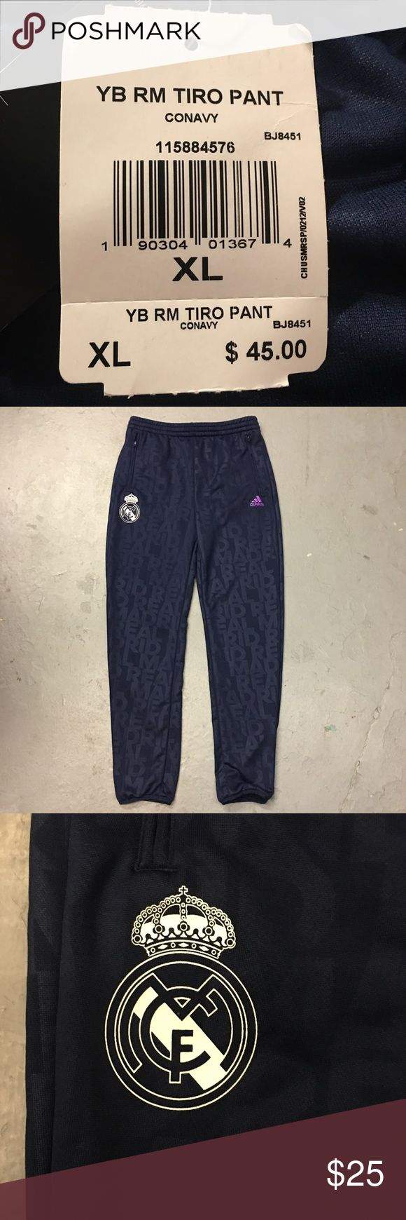 New Adidas Real Madrid Youth Tiro Pants Brand new Adidas Real Madrid Tiro Pants that have never been worn. These are navy blue pants that will definitely show how much you love Real Madrid! adidas Bottoms Sweatpants & Joggers