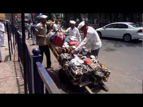 Dabbawalas in action at a Mumbai Suburban Railway station