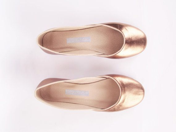 Rose-gold ballet flats are crafted from up-cycled leather.