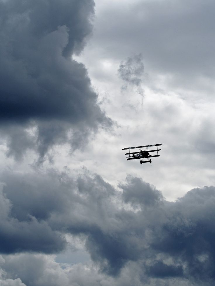 Åsa Larsson - Bland molnen. A lone airplane in the clouds. Available as poster and laminated picture at Printler, the marketplace for photo art.