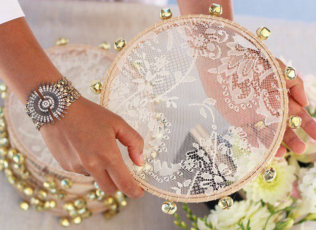 Pin for Later: 22 DIYs For the Most Glamorous Wedding Imaginable Lace Tambourine Is there anything prettier than this DIY lace tambourine? Guests can shake them after your nuptials are complete!