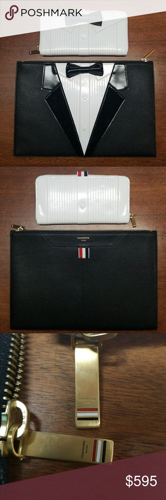 "Thom Browne Tuxedo Handbag & Wallet Thom Browne bundle, includes:  Tuxedo Zip Around Leather Wallet, Trompe L'oeil tux long zip around wallet in calf leather + pebble grain in black and white, 100%leather, approx 8.5"" x 4.25"", back button is rubbed from handling. Minor handling wear, appears unused. Originally around $1390.  Tuxedo Pouch, Trompe L'oeil tux document wallet (AT), approx 13.75"" x 9.75"", easily fits sheets of paper, pebble grain, patent and calf leather, 100% leather. Currently…"