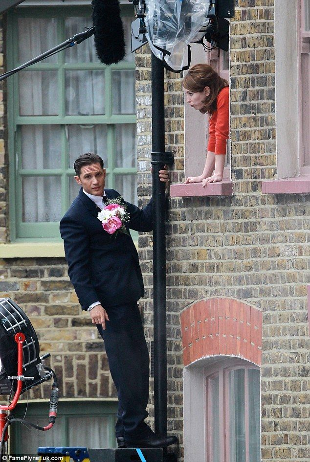 In full bloom: The actor tucked a bouquet into his jacket before making the climb, although he was aided by a trusty step