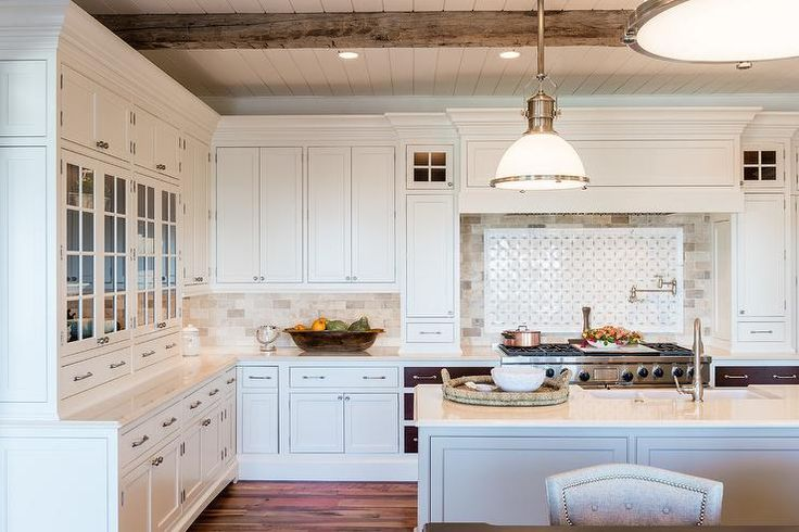 Large white transitional kitchen boasts Country Industrial Pendants hung above a white island topped with a white quartz countertop fitted with a dual farmhouse sink paired with a satin nickel gooseneck faucet.
