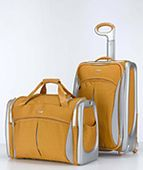 What to Pack for Your Island Casual Tahiti Vacation: Tumi T3 luggage in Solar color.