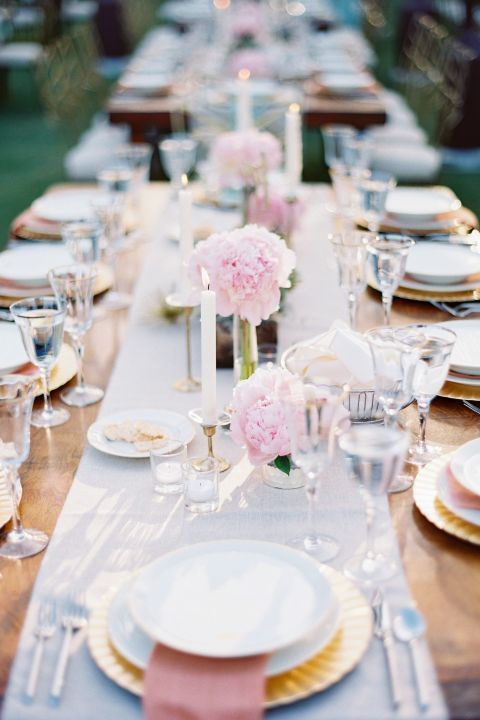 We love the look of these sweet pink peonies arranged in bud vases down the length of the table. Get the tutorial.
