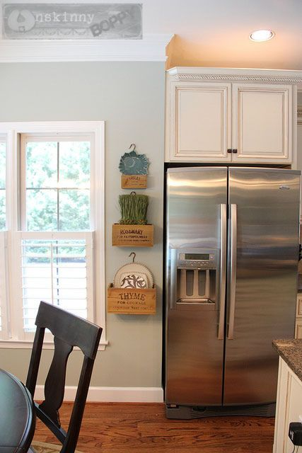 From Yellow to Blue: a Kitchen Transformation. Wall color:  Restoration Hardware, Silver Sage.  Like the 3 wood crates on the wall by the refrigerator.