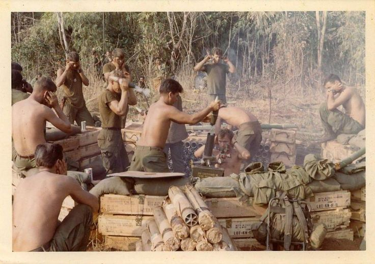 Vietnam Mortar Fire : A th infantry division mortar team prepares to fire in