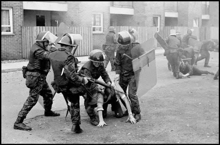 GB. NORTHERN IRELAND. Londonderry. British soldiers drag ringleaders from the rock throwing mob and beat them severely. 1971.
