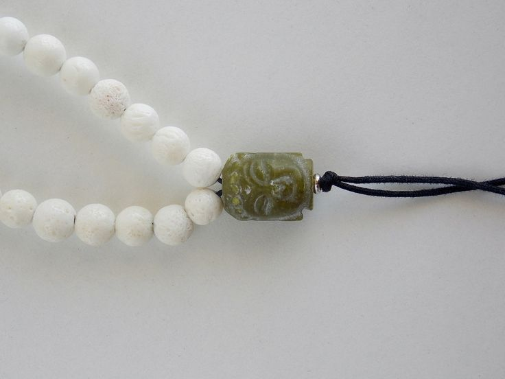 Rosary Mala with white coral and green jade with silver elements- Price:62.00€