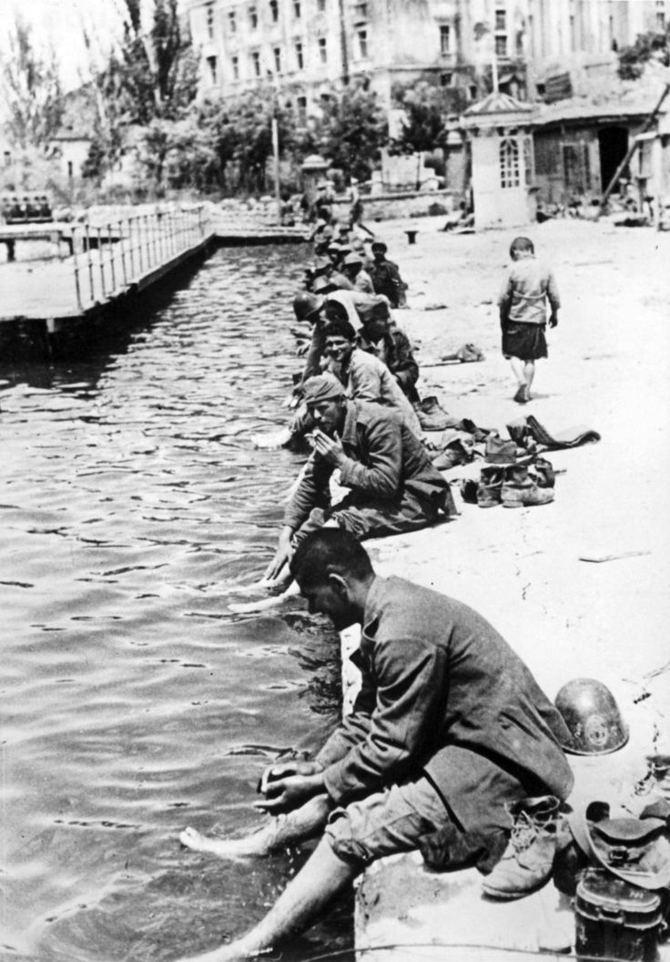Axis Romanian soldiers cool themselves on a pier in Balaklava following the successful Axis Siege of Sevastopol, in which German, Romanian and Italian forces captured Sevastopol, a port city on the Crimean Peninsula on the Black Sea. The bloody siege...pin by Paolo Marzioli
