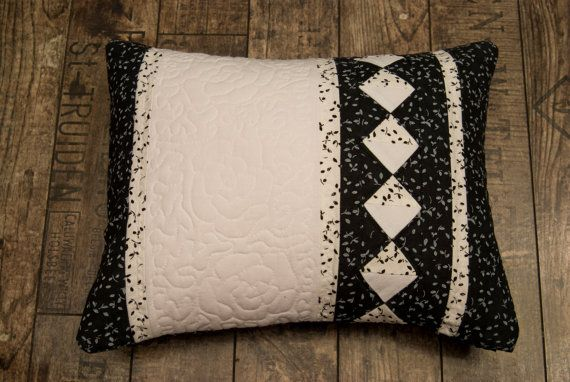 Black and white cushion with quilting roses by Maggiepatchwork