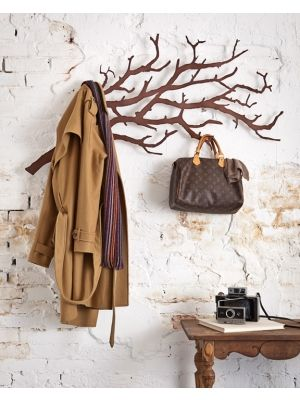 The Tree Branch Wall Hanger brings the beauty of the outdoors inside. There are two different sized branches that make it the perfect place to hang anything from a coat, to a purse, jewelry, photos or even important notes that you may need to remember.