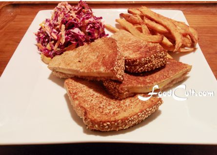 #grilledcheese - a classic #vegetarian #diner dish is in its revival. We search for ways to turn this old favorite into something with refreshed flavours. Some breads work, some don't.  We don't like #raspberry #bread for a #grilled #cheese #sandwich. This #loaf is a light #wholewheat with #fiber boosters include #chiaseed, #Pumpkin #seeds were added at the forming stage. #frenchfries are from a single #russet #potato. Red #cabbage #coleslaw dressing uses #pomegranate #vinegar