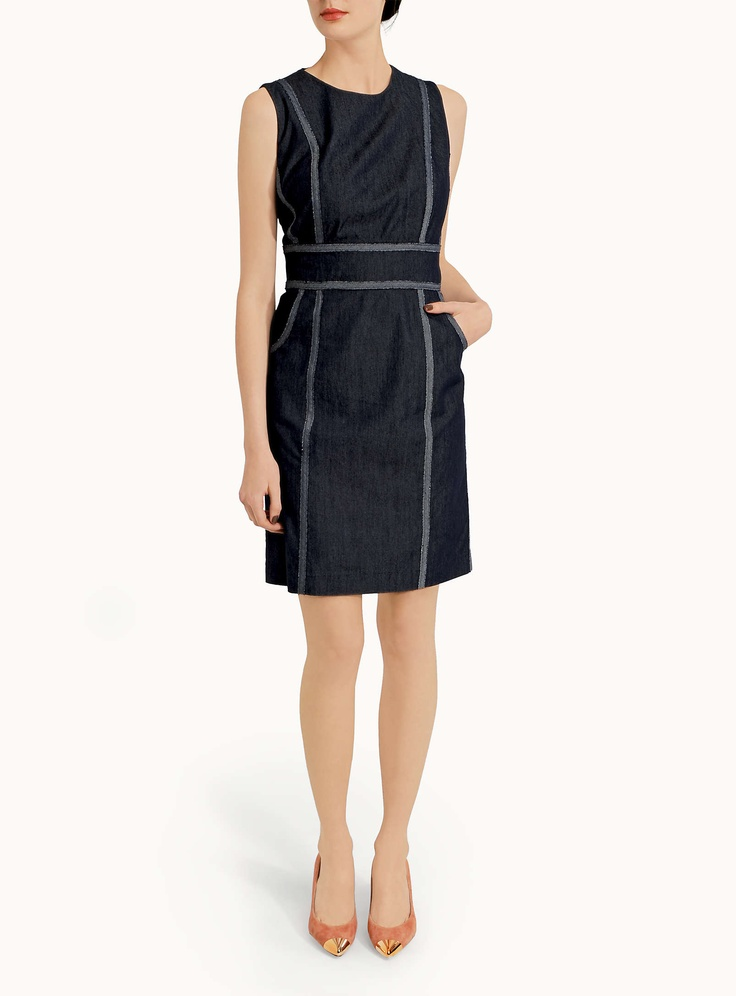 Sharagano  Graphic ribbon dress  $78.00  Style: 9072-5675    - Sharagano at Contemporaine  - Chic and casual dress made of soft denim with a raw-cut graphic ribbon trim  - Well-defined, fitted waistband  - Sleeveless style  - Small, crew neck  - Two slant pockets  - Hidden zip behind