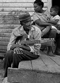 John Adam Estes (January 25, 1899– June 5, 1977, best known as Sleepy John Estes or Sleepy John, was a blues guitarist, songwriter and vocalist, born in Ripley, Lauderdale County, Tennessee.  In 1915, Estes' father, a sharecropper who also played some guitar, moved the family to Brownsville, Tennessee. Not long after, Estes lost the sight of his right eye when a friend threw a rock at him during a baseball game. At the age of 19 he began to perform professionally.