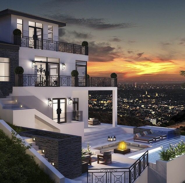 This exterior has a nice old-world wrought-iron meets modern balance, and especially nice three-tier terrace design... that view, though!!! - Luxury Homes