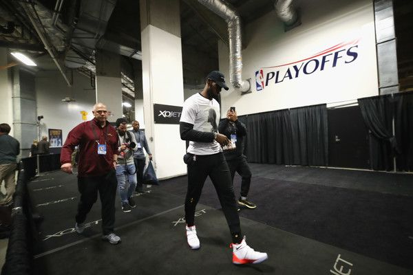 LeBron James Photos Photos - LeBron James #23 of the Cleveland Cavaliers walks to a press conference before practice for the 2017 NBA Finals at ORACLE Arena on May 31, 2017 in Oakland, California. NOTE TO USER: User expressly acknowledges and agrees that, by downloading and or using this photograph, User is consenting to the terms and conditions of the Getty Images License Agreement. - 2017 NBA Finals - Practice and Media Availability