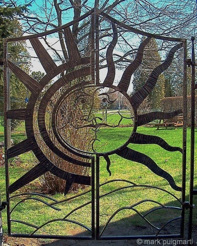 Sun, Two Door Garden Gate by Mark Puigmarti