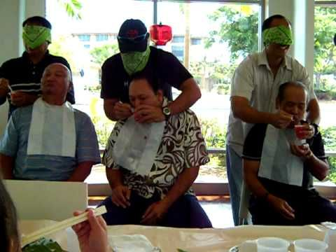 How to make a baby.      There are three men sitting on the chairs and three men behind them blind folded.  What they had to was feed the person sitting down the fastest.    Aunty Marie's baby shower Sept. 11, 2010    =]