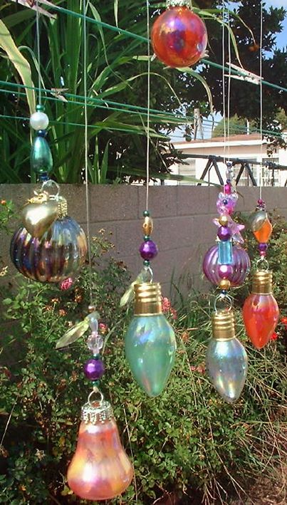 Old light bulbs painted with nail polish used as tree jewelry.